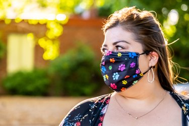 woman looking away weraing a colorful protective face mask