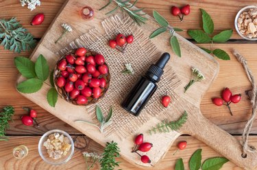 A bottle of rosehip seed oil with sage, wormwood, winter savory and other herbs