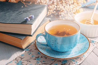 warm tea and a book in the sunshine
