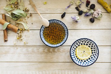 Honey lemon tea with cinnamon. Top view. Image toned.