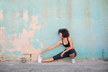 Girl doing stretching in the street