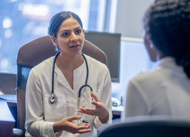 Doctor and Patient Consultation stock photo