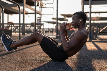 Fit black man doing ab exercises