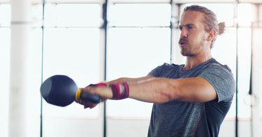 man doing kettlebell swing exercise