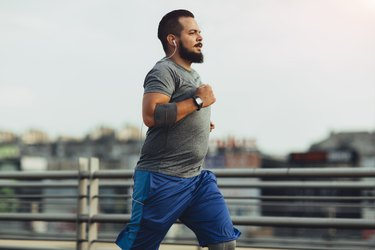 Man measuring his heart rate while running