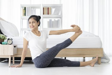 Woman doing a low-impact workout in her bedroom