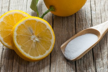 Lemon and Carbonate powder or baking soda on wooden table, alternative medicine, organic cleaner