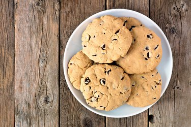 Plate of traditional chocolate chip cookies on rustic wood