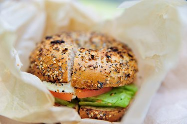 Healthy bagel with lettuce, cheese and tomato