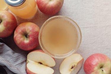 Apple cider vinegar with mother in glass bowl, probiotics food for gut health