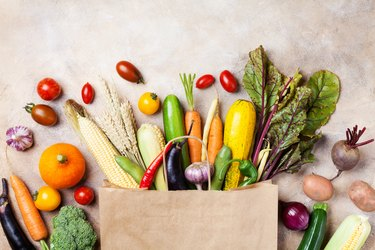 healthy autumn vegetables in paper grocery bag