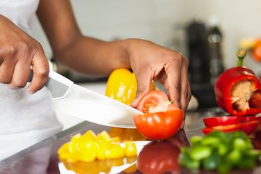A woman on Weight Watchers slicing up vegetables for dinner