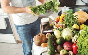 Abundance of fruits and vegetables on a wooden table in a home kitchen