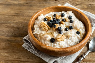 Top view of oatmeal with blueberries as an example of the best foods for hiatal hernia