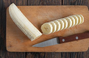 Ripe bananas and a sliced
