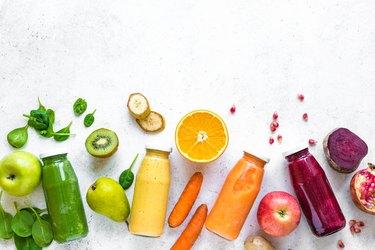 Various smoothies bottles and ingredients