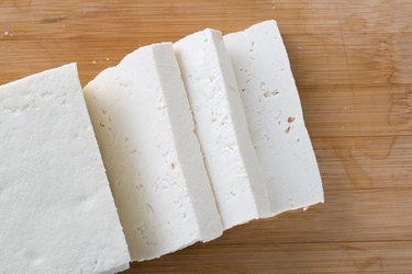 Top view of tofu on wooden table
