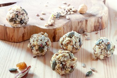 Home cooking dates energy homemade organic seeds nuts vegan oatmeal balls wooden rustic background