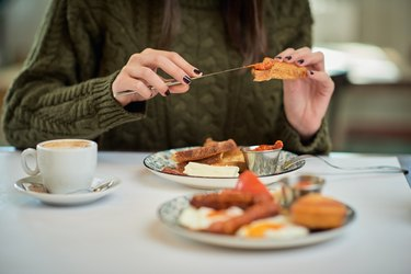 Woman having French toast for breakfast