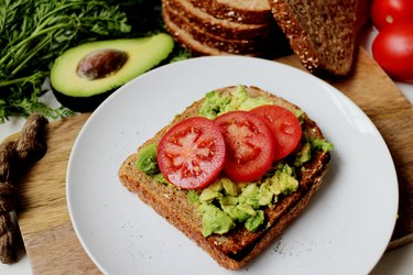 Whole-wheat toast with avocado and tomato for heart-healthy diet for people with diabetes