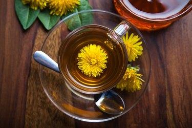dandelion tisane tea with yellow blossom inside teacup