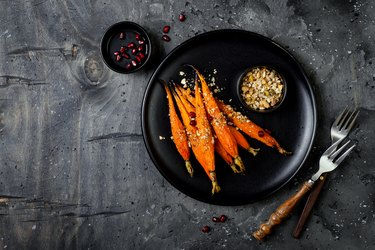 Roasted carrots with dukkah. Vegetarian food. Top view, flat lay, copy space
