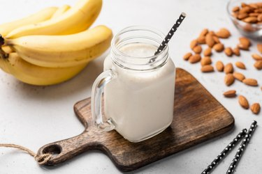 Banana protein smoothie in drinking glass