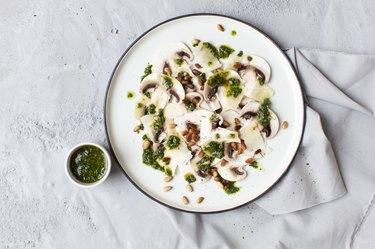 Mushroom carpaccio with basil pesto and parmesan