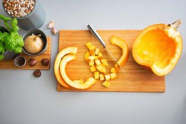 Pumpkin on cutting board. Closeup