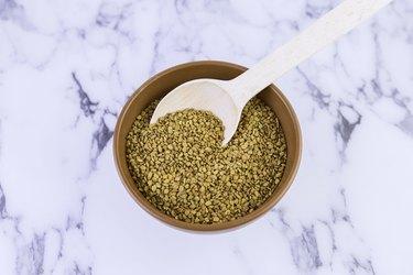 Fenugreek (Yellow tea, Methi, Shambala) seeds on white background