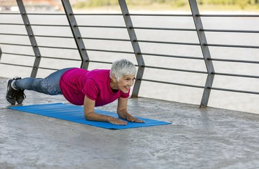 Senior adult woman exercising outdoors.