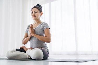 Woman doing yoga exercises at home