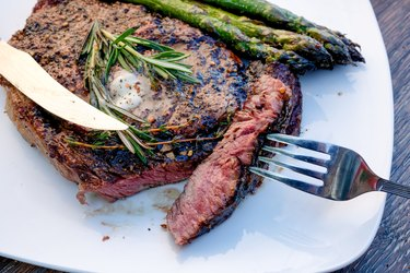 Delicious Rib Eye Steak Grilled to Perfection with Asparagus on the Side Ready to Eat
