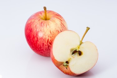 Close-Up Of Fresh Apples On White Background
