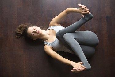 Top view of Supta Gomukhasana yoga pose