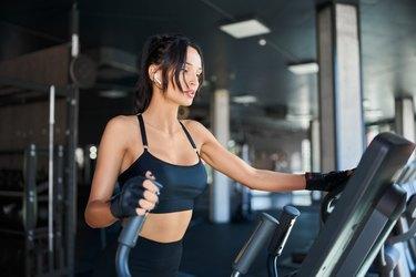 Fitness woman training on treadmill.