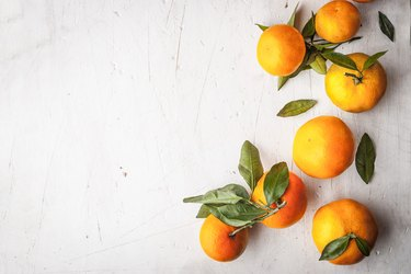 Mandarins at the right on the white wooden table horizontal