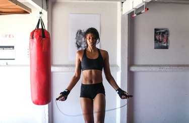 a Young woman training for combat sports.