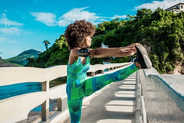 Woman living a healthy lifestyle by exercising outdoors