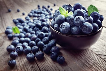 resveratrol-rich blueberries in bowl and scattered on table