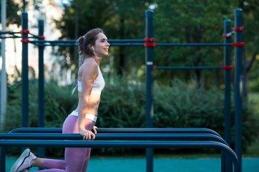 Woman performing triceps dips.