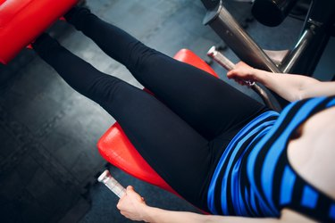 Young woman exercising. Fitness in gym.