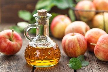 Organic apple cider vinegar in a glass bottle
