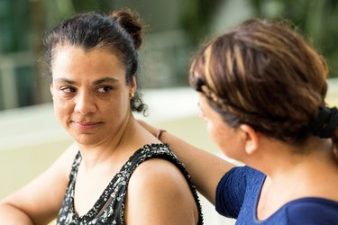 woman comforting friend coping with breast cancer