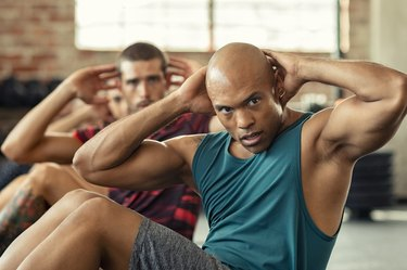 Men doing sit ups during a workout class