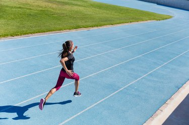 Runner sprinting towards success on running track