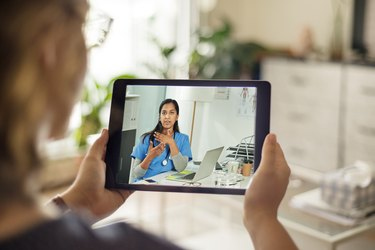 An older woman a telemedicine visit with her doctor from home