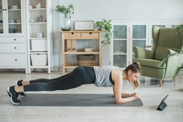 Woman doing a Pilates workout in her living room