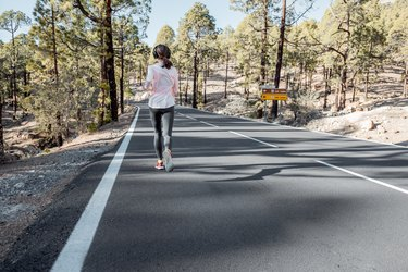 Woman jogging on the mountain road