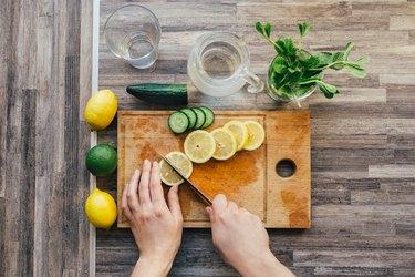 woman cutting lemon